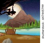 man climbing rock on fullmoon... | Shutterstock .eps vector #647445799