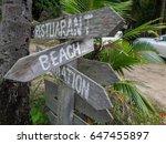 wooden signboard on tropical... | Shutterstock . vector #647455897