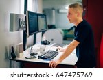 young man working in printing... | Shutterstock . vector #647475769