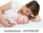 woman and newborn kid boy relax ... | Shutterstock . vector #647496439