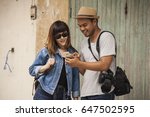 young woman ask directions from ... | Shutterstock . vector #647502595