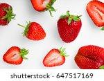 ripe strawberries on white... | Shutterstock . vector #647517169