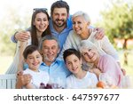 family sitting at table... | Shutterstock . vector #647597677