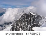 cloudy mountain peaks in snow....