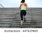 sporty female running up on... | Shutterstock . vector #647619805