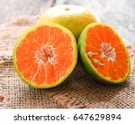 fresh oranges on wood | Shutterstock . vector #647629894