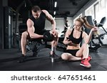 man training with dumbbell... | Shutterstock . vector #647651461