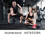 man training with dumbbell... | Shutterstock . vector #647651584