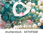 Necklace with heart and pink stone. - stock photo