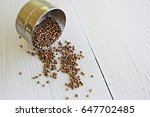 coriander seeds in stainless... | Shutterstock . vector #647702485