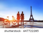 couple with bicycle looking at... | Shutterstock . vector #647722285