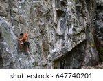 Rock Climber Climbing A Steep...
