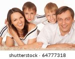 happy family of four on a light | Shutterstock . vector #64777318