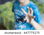 young boy play with fidget... | Shutterstock . vector #647775175