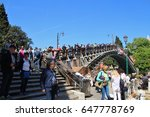 Small photo of Venice, Italy - April 8, 2017: Many tourists on the bridge ponte dell Academia which connects the districts of Dorsoduro and San Marco. Located next to the Peggy Guggenheim collection. Europe.