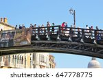 Small photo of Venice, Italy - April 8, 2017: Many tourists on the bridge ponte dell' Academia which connects the districts of Dorsoduro and San Marco. Located next to the Peggy Guggenheim collection. Italy, Europe.