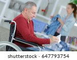 man in wheelchair reading book  ... | Shutterstock . vector #647793754