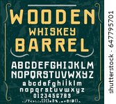 wooden whiskey barrel font... | Shutterstock .eps vector #647795701
