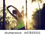 young female runner warming up... | Shutterstock . vector #647835331