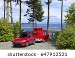 red car with tiny camper... | Shutterstock . vector #647912521