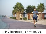 man running on a running track... | Shutterstock . vector #647948791