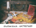 Small photo of Treasure map of an adventurer and his belongings