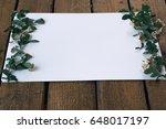 spiraea branches on white sheet   Shutterstock . vector #648017197