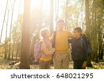 three smiling kids standing in... | Shutterstock . vector #648021295