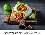 tasty burrito with vegetables ... | Shutterstock . vector #648037981