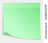 green sticky note with...