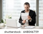 smiling businessman looking at... | Shutterstock . vector #648046759