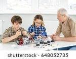 young boy and girl enjoying... | Shutterstock . vector #648052735