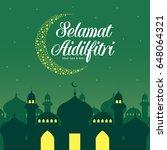 selamat hari raya aidilfitri... | Shutterstock .eps vector #648064321