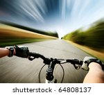 rider driving bicycle on an... | Shutterstock . vector #64808137