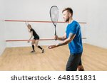 couple with squash rackets ... | Shutterstock . vector #648151831