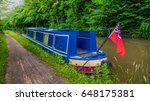 blue narrow boat moored at the... | Shutterstock . vector #648175381