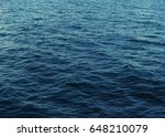 surface of calm blue sea with... | Shutterstock . vector #648210079