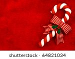 A Candy Cane With A Bow On A...