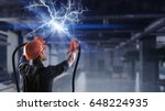 fixing electricity cut | Shutterstock . vector #648224935