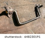 Small photo of Ancient homemade chest the handle of an ancient self-made chest against the background of an old wooden surface