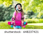 child riding skateboard in... | Shutterstock . vector #648237421