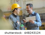 workers talking and laughing at ... | Shutterstock . vector #648243124
