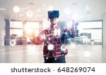 young man with virtual reality... | Shutterstock . vector #648269074