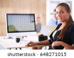 young woman working in office ... | Shutterstock . vector #648271015