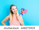 young woman with flags of... | Shutterstock . vector #648273925
