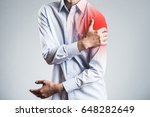 male holding a shoulder  sick | Shutterstock . vector #648282649