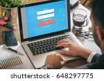 young man in his office   login ... | Shutterstock . vector #648297775