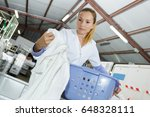 laundress taking out a clean... | Shutterstock . vector #648328111