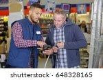 male customer in a hardware... | Shutterstock . vector #648328165