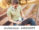 young man sitting in the park... | Shutterstock . vector #648343099